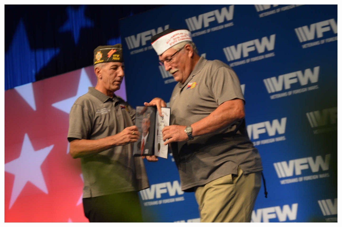 VFW Department of Ilinois Past Commander Don Boyer accepts Certificate from Commander in Chief BJ Lawrence for attaining All American status