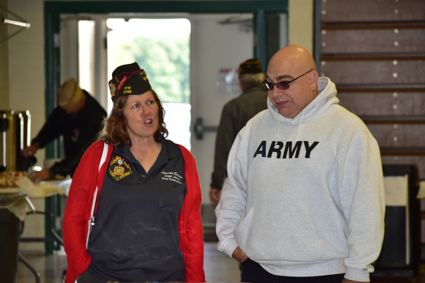 Laurie Emmer, Department Illinois VFW Jr Vice Commander, talks with District 3 Sr Vice Commander Chris Garza.