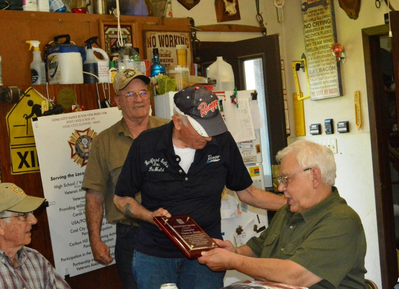 Sr. Vice Commander Irv DeWald presents outgoing Commander Charlie Brown with a plaque commemorating his service to St. Juvin Post.